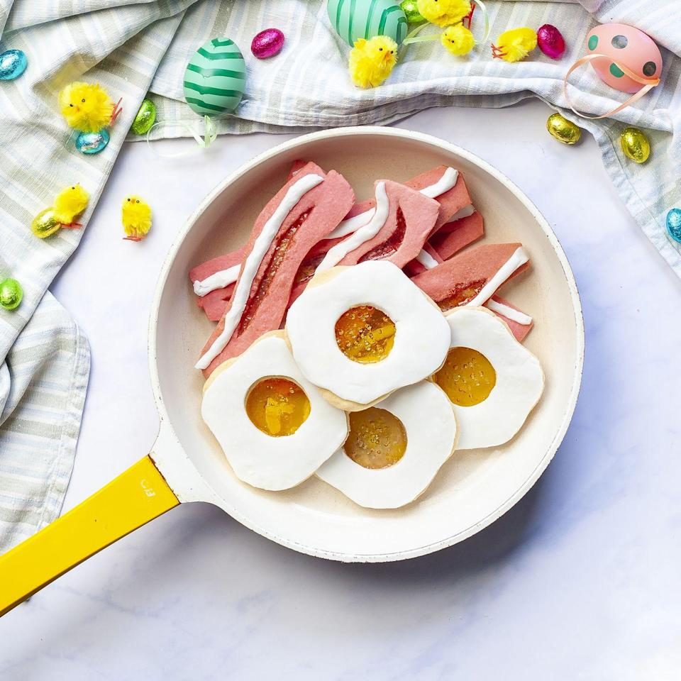 """<p>Who wouldn't want breakfast at teatime?! Amuse your guests with these sweet egg and bacon biscuits.</p><p><strong>Recipe: <a href=""""https://www.goodhousekeeping.com/uk/easter/easter-recipes/a35901619/fried-egg-bacon-biscuits/"""" rel=""""nofollow noopener"""" target=""""_blank"""" data-ylk=""""slk:Fried Egg and Bacon Biscuits"""" class=""""link rapid-noclick-resp"""">Fried Egg and Bacon Biscuits</a></strong></p>"""