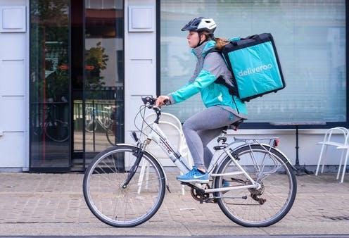 """<span class=""""caption"""">Deliveroo is one of several rapid delivery companies that have gained popularity during the COVID-19 pandemic.</span> <span class=""""attribution""""><a class=""""link rapid-noclick-resp"""" href=""""https://www.shutterstock.com/image-photo/ghent-belgium-may-1-2018-female-1081343123"""" rel=""""nofollow noopener"""" target=""""_blank"""" data-ylk=""""slk:Thomas Dekiere/Shutterstock"""">Thomas Dekiere/Shutterstock</a></span>"""