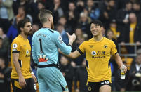 Wolverhampton Wanderers' Hwang Hee-chan, right, celebrates with Wolverhampton Wanderers' goalkeeper Jose Sa and Wolverhampton Wanderers' Ruben Neves after the English Premier League soccer match between Wolverhampton Wanderers and Newcastle United at Molineux stadium in Wolverhampton, England, Saturday, Oct. 2, 2021. (AP Photo/Rui Vieira)