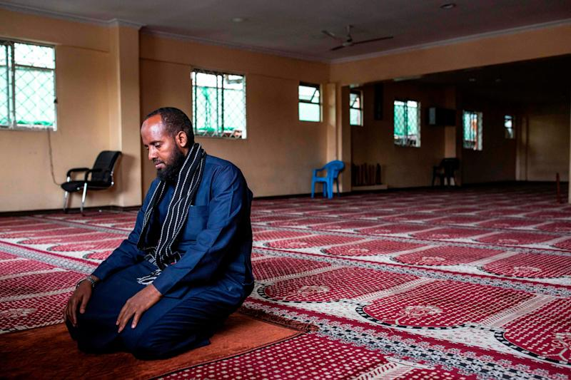 Imam Mohamed Yusuf prays alone at the Andalus Mosque in Eastleigh, Nairobi, on March 27, 2020, as the government banned mass prayers in mosques to curb the spread of the COVID-19 coronavirus.
