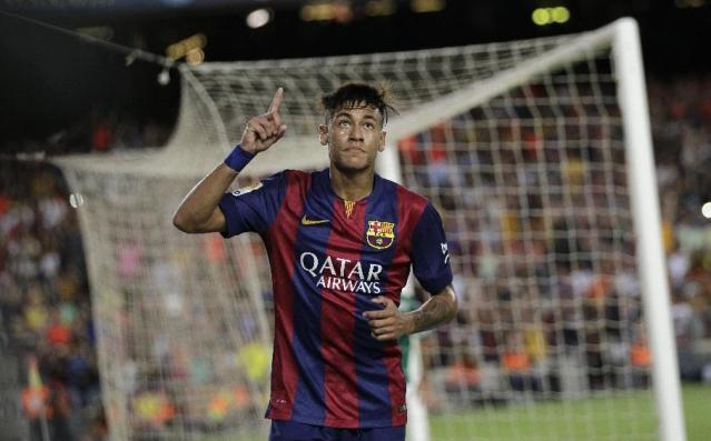 Barcelona's Neymar, from Brazil, celebrates scoring his side's second goal during the Joan Gamper trophy friendly soccer match between Barcelona and Leon at the Camp Nou stadium in Barcelona, Spain, Monday, Aug. 18, 2014. (AP Photo/Emilio Morenatti)