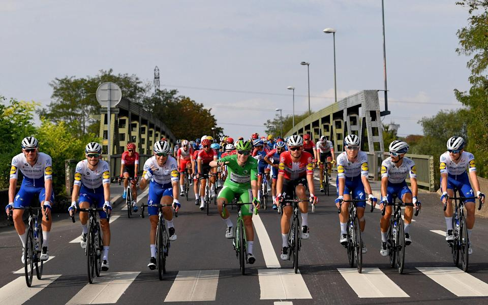 Deceuninck-Quick Step's entire team ride along side-by-side during the final stage of last year's Tour de France –Tour de France teams 2021: Full list of teams and riders starting in Brittany - GETTY IMAGES