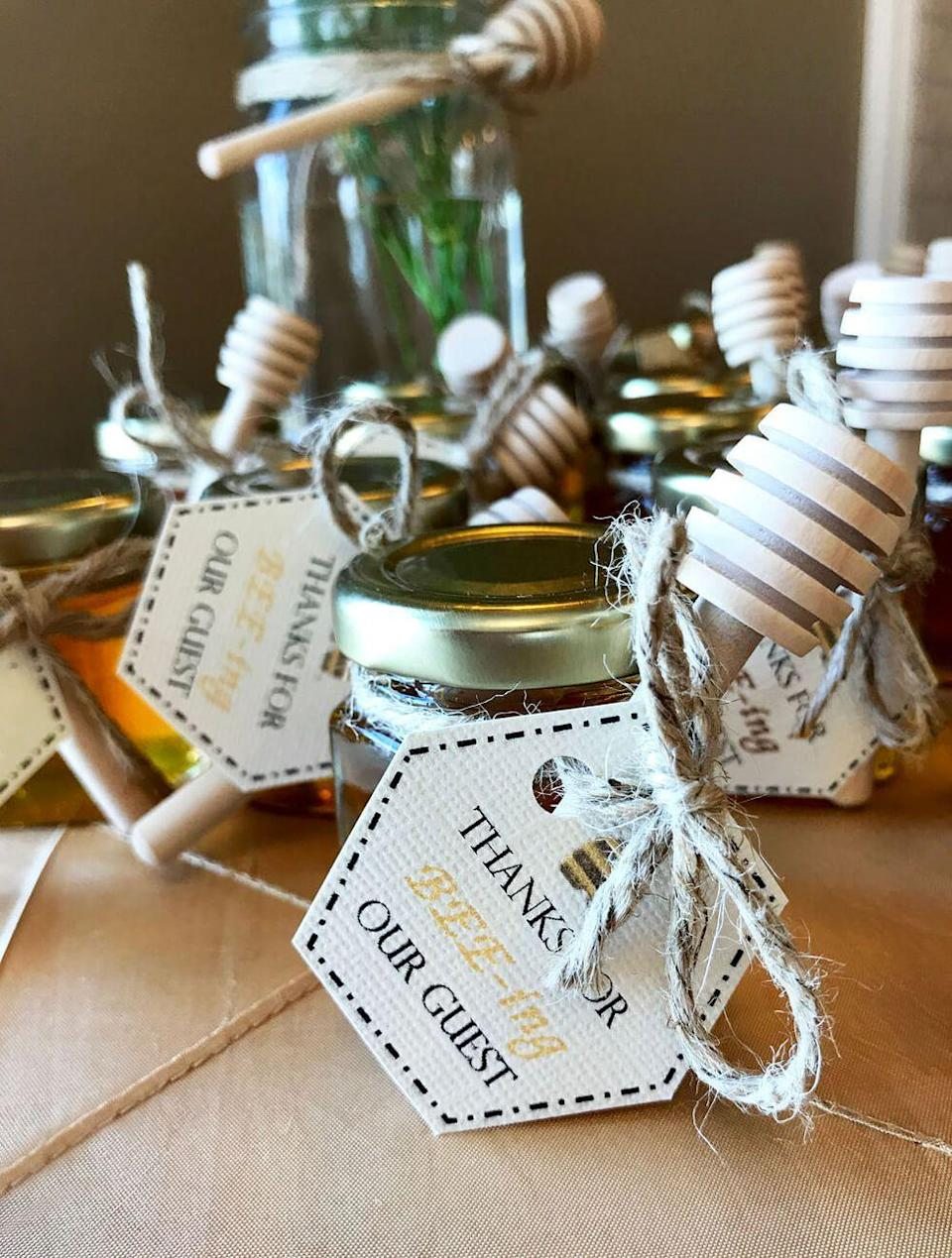 """<p>These bee-themed favor tags are a sweet way to end any summer bridal shower. Locally sourced honey doubles the charm of the gift.</p><p><strong>Get more information at <a href=""""https://halfpintpartydesign.com/mommy-to-bee-baby-shower/"""" rel=""""nofollow noopener"""" target=""""_blank"""" data-ylk=""""slk:Halfpint Design"""" class=""""link rapid-noclick-resp"""">Halfpint Design</a>.</strong></p>"""