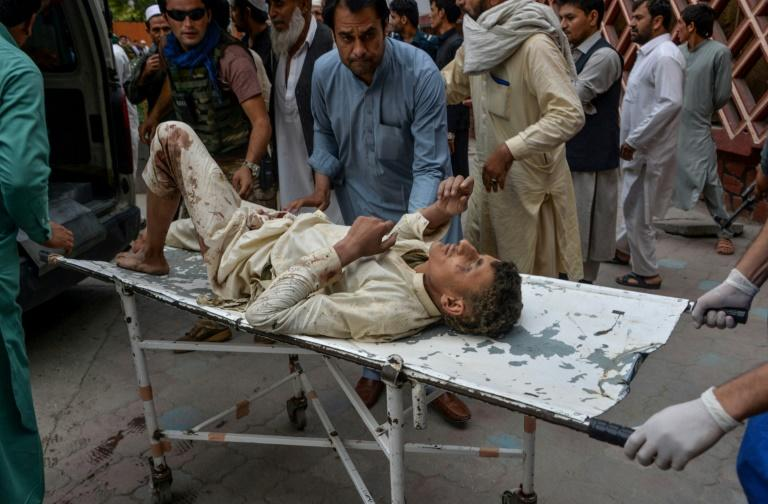 The deadly blast in Afghanistan's eastern province of Nangarhar also wounded at least 36 people, including this man being carried to hospital