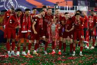 Liverpool players (from left) Joe Gomez, Alex Oxlade-Chamberlain, Adam Lallana, James Milner, Jordan Henderson, Andrew Robertson and Trent Alexander-Arnold pose with the Premier League trophy. (PHOTO: Phil Noble/POOL/AFP via Getty Images)