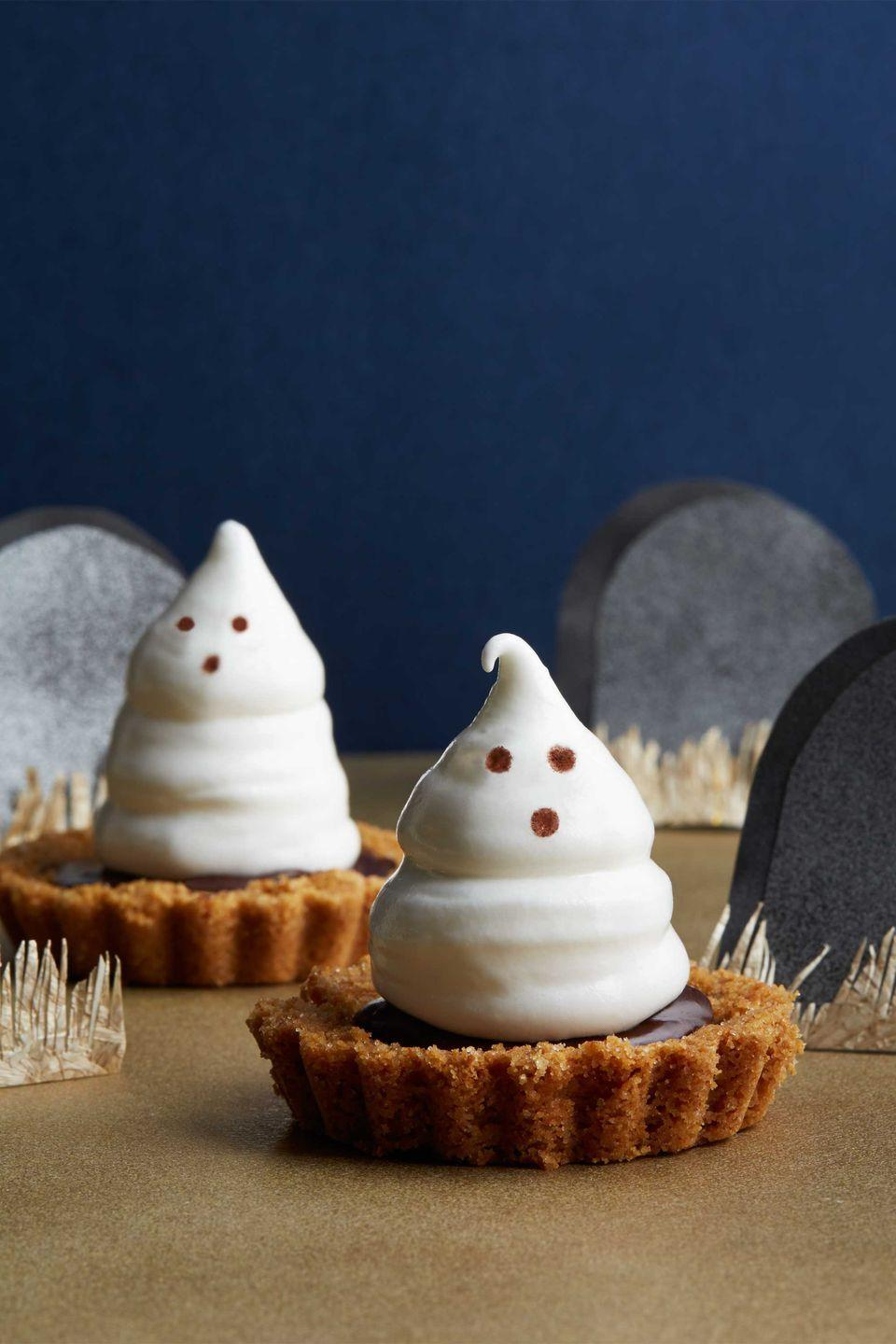 """<p>Boo! Knock guests' socks off with meringue-topped chocolate ganache tartlet—the perfect sweet and spooky Halloween dessert.</p><p><strong><a href=""""https://www.countryliving.com/food-drinks/recipes/a5910/meringue-ghost-tartlets-recipe-clx1014/"""" rel=""""nofollow noopener"""" target=""""_blank"""" data-ylk=""""slk:Get the recipe"""" class=""""link rapid-noclick-resp"""">Get the recipe</a></strong>.</p>"""