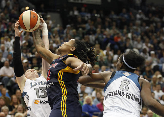 Minnesota Lynx guard Lindsay Whalen (13) tries to steal a pass from Indiana Fever forward Erlana Larkins (2) in the second half of Game 2 of the WNBA basketball Finals Wednesday, Oct. 17, 2012, in Minneapolis. The Lynx won 83-71. (AP Photo/Stacy Bengs)