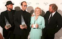 Barbara Gibb was the matriarch of the Gibb family, which included her sons in the Bee Gees (Barry, Maurice, and Robin Gibb, shown here) and Andy Gibb. She passed away on Aug. 12 at age 95, after outliving three of her children: Andy, Maurice, and Robin. (Photo: AP/Michael Caulfield)