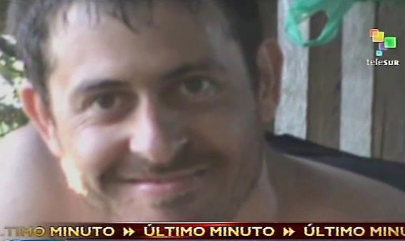 This video frame grab made from Venezuela's Telesur via APTN, shows French journalist Romeo Langlois, a few hours after he was captured on April 28, 2012 by rebels of the Revolutionary Armed Forces of Colombia, FARC. Langlois had been accompanying Colombian troops on a cocaine-lab destruction mission when they were attacked by FARC rebels. Colombian rebels released the video of Langlois Monday, May 28, 2012, and they say they plan to release him Wednesday. (AP Photo/Telesur via APTN)
