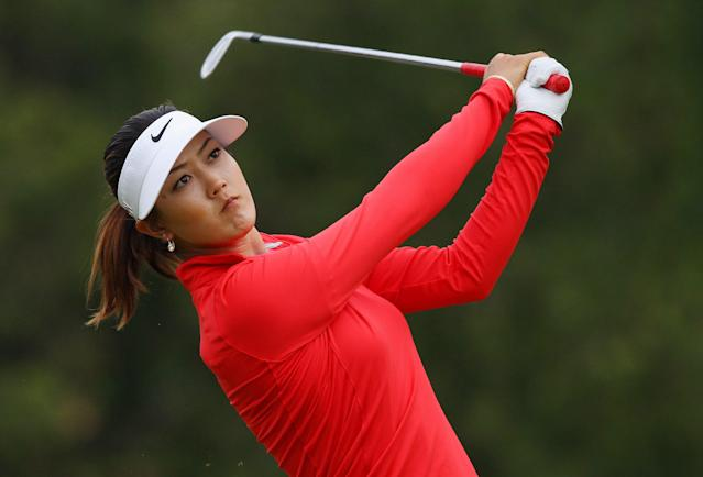 Michelle Wie watches her fairway shot on the third hole in the final round of the Manulife Financial LPGA Classic golf tournament Sunday, June 8, 2014, in Waterloo, Ontario. (AP Photo/The Canadian Press, Dave Chidley)