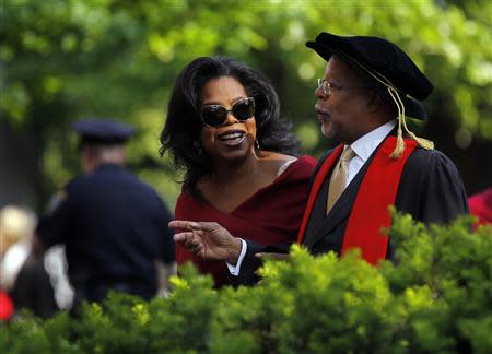 File photo of media mogul Winfrey and professor Henry Louis Gates Jr arriving for Harvard University's 362nd Commencement Exercises in Cambridge