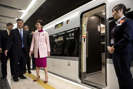Ma Xingrui, governor of Guangdong Province, and Carrie Lam, Hong Kong's chief executive, stand next to a Guangzhou-Shenzhen-Hong Kong Express Rail Link (XRL) Vibrant Express train bound for Guangzhou Nan Station on a platform in the Mainland Port Area at West Kowloon Station, which houses the terminal for the XRL, developed by MTR Corp., in Hong Kong, China, September 22, 2018. Giulia Marchi/Pool via REUTERS