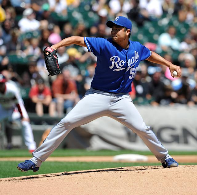 Kansas City Royals' Bruce Chen (52) pitches against the Chicago White Sox during the first inning of the MLB American League baseball game Sunday, July 28, 2013, in Chicago. (AP Photo/Jim Prisching)