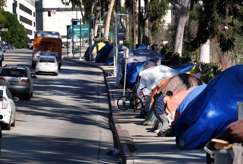 Tents from a homeless encampment line a street in downtown Los Angeles earlier this year.
