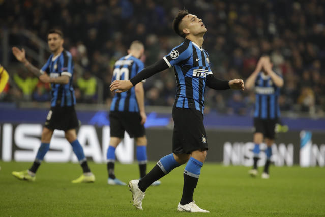 Inter Milan's Lautaro Martinez, second right, reacts after his goal was disallowed for offside during the Champions League, group F soccer match between Inter Milan and F.C. Barcelona, at the San Siro stadium in Milan, Italy, Tuesday, Dec. 10, 2019. (AP Photo/Luca Bruno)