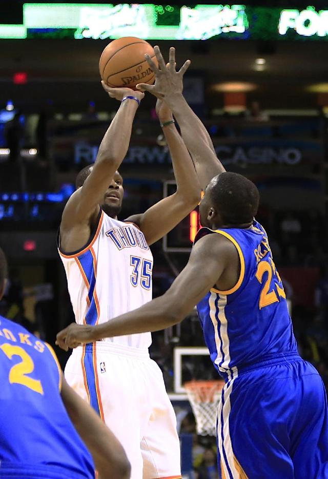 Oklahoma City Thunder small forward Kevin Durant (35) shoots as Golden State Warriors small forward Draymond Green (23) defends during the fourth quarter of an NBA basketball game Friday, Jan. 17, 2014, in Oklahoma City. Oklahoma City won 127-121. AP Photo/Alonzo Adams)