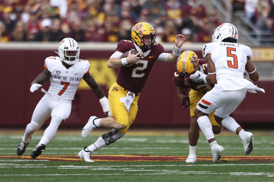 Minnesota quarterback Tanner Morgan (2) scrambles with the ball during an NCAA college football game against Bowling Green, Saturday, Sept. 25, 2021, in Minneapolis. (AP Photo/Stacy Bengs)