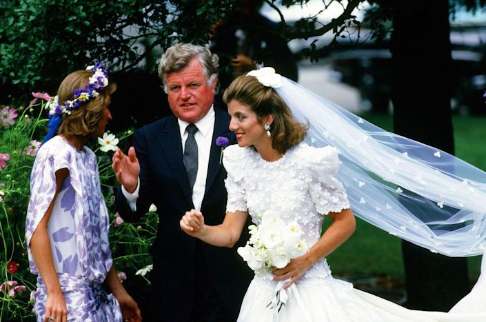 <p>Caroline, accompanied by Ted Kennedy at her wedding.</p>
