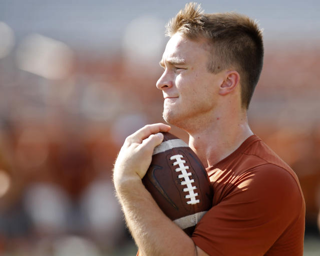 Texas Longhorns' Sam Ehlinger carries the ball during Family Friday practice held Friday Sept. 6, 2019 at Darrell K Royal-Texas Memorial Stadium in Austin, Tx. ( Photo by Edward A. Ornelas )