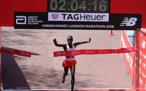 Eliud Kipchoge crossing the finish line - Credit: GETTY IMAGES