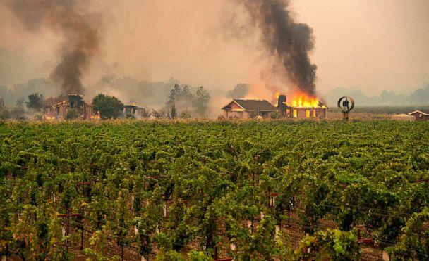 PHOTO: A building is engulfed in flames at a vineyard during the Kincade fire near Geyserville, California on October 24, 2019. (Josh Edelson/AFP via Getty Images)