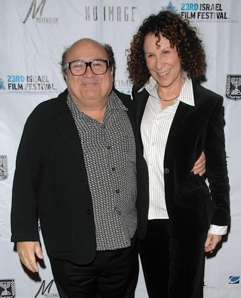 "FILE - This Oct. 29, 2008 file photo shows actors Danny Devito, left, and Rhea Perlman attending the opening night of the 23rd Annual Israel Film Festival at the Ziegfeld Theatre in New York. A spokesman for DeVito says the couple is separating after 30 years of marriage. Publicist Stan Rosenfield offered no other details. DeVito and Perlman married in 1982 and have three adult children. Together, the couple established the production company Jersey Films, which counts ""Pulp Fiction,"" ""Erin Brockovich"" and ""Out of Sight"" among its credits. DeVito stars in TV's ""It's Always Sunny in Philadelphia."" Perlman is best known for her long-running role as Carla the waitress on ""Cheers."" (AP Photo/Peter Kramer, file)"