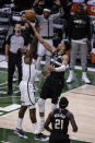 Milwaukee Bucks forward Giannis Antetokounmpo (34) shoots against the Brooklyn Nets during the second half of Game 6 of a second-round NBA basketball playoff series Thursday, June 17, 2021, in Milwaukee. (AP Photo/Jeffrey Phelps)