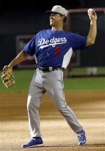 Los Angeles Dodgers manager Don Mattingly throws during batting practice prior to a baseball game against the Arizona Diamondbacks, Tuesday, July 9, 2013, in Phoenix. (AP Photo/Matt York)