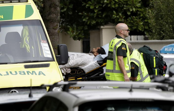<p>Ambulance staff take a man from outside a mosque in central Christchurch, New Zealand. (AP Photo/Mark Baker) </p>