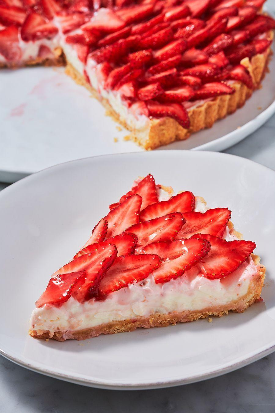 """<p>Nothing says spring quite like this easy strawberry tart. The crust is a simple no-chill version of a pie crust that we are obsessed with.</p><p>Get the <a href=""""http://www.delish.com/uk/cooking/recipes/a32484927/strawberry-tart-recipe/"""" rel=""""nofollow noopener"""" target=""""_blank"""" data-ylk=""""slk:Strawberry Tart"""" class=""""link rapid-noclick-resp"""">Strawberry Tart</a> recipe.</p>"""