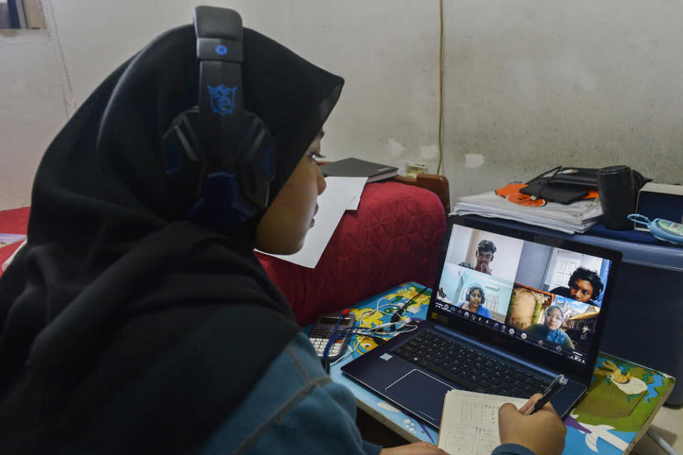 A student attends an online class from home during movement control order (MCO) in Petaling Jaya on January 26, 2021. — Picture by Miera Zulyana