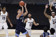 Villanova's Collin Gillespie goes up for a shot during the first half of the team's NCAA college basketball game against Arizona State, Thursday, Nov. 26, 2020, in Uncasville, Conn. (AP Photo/Jessica Hill)