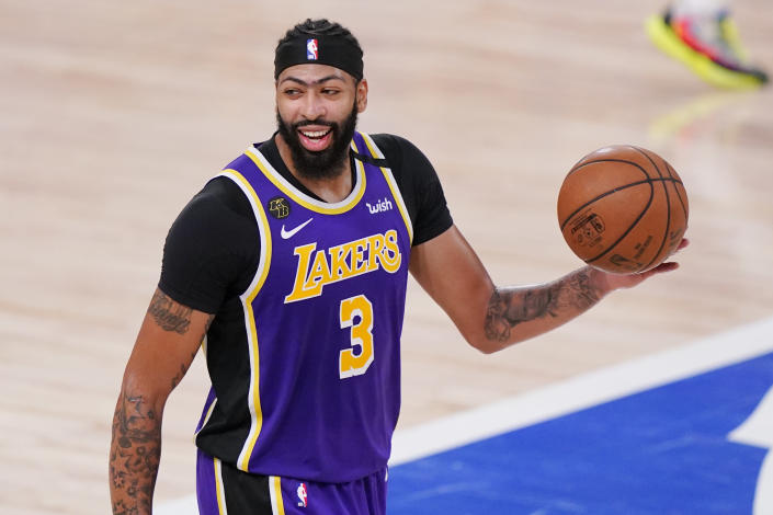 Los Angeles Lakers' Anthony Davis (3) celebrates after the Lakers beat the Denver Nuggets in an NBA conference final playoff basketball game Saturday, Sept. 26, 2020, in Lake Buena Vista, Fla. The Lakers won 117-107 to win the series 4-1. (AP Photo/Mark J. Terrill)