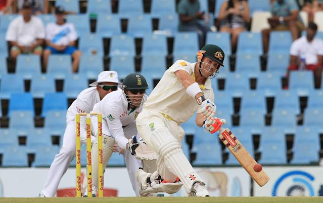 Australia's batsman David Warner, right, plays a stroke shot as South Africa's wicketkeeper AB de Villiers, centre, and captain Graeme Smith, left, watch on the third day of their their cricket Test match at Centurion Park in Pretoria, South Africa, Friday, Feb. 14, 2014. (AP Photo/ Themba Hadebe)