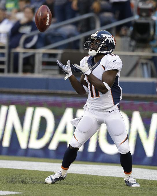 FILE - In this Aug. 17, 2013 file photo, Denver Broncos' Trindon Holliday catches a kick off against the Seattle Seahawks in the first half of a preseason NFL football game in Seattle. Holliday piled up an NFL-record 248 yards in returns against the Baltimore Ravens in January. (AP Photo/Elaine Thompson)