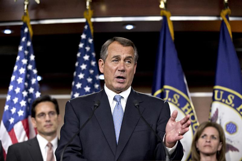 Speaker of the House John Boehner, R-Ohio, speaks to reporters after the House Republicans voted for their leadership for the next session of Congress, at the Capitol in Washington, Wednesday, Nov. 14, 2012. He is flanked by Majority Leader Eric Cantor, R-Va., left, and Rep. Lynn Jenkins, R-Kan., right. (AP Photo/J. Scott Applewhite)