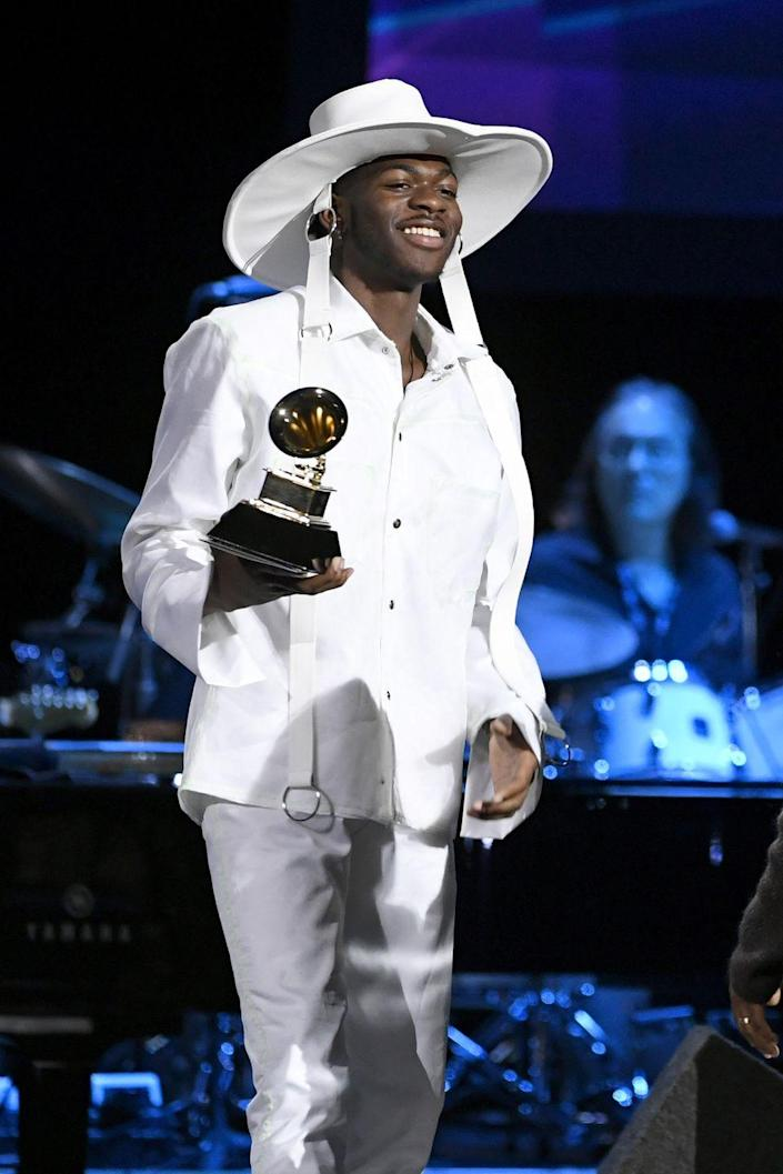 <p>While accepting his Grammy Award, the rapper wore an all-white shirt and pants combo, with a wide-brim hat to match. I mean, he does love his hats. </p>