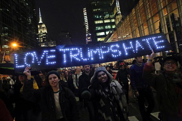 <p>The Empire State Building is seen in the background as demonstrators hold a sign during a march against President-elect Donald Trump in Manhattan, New York, U.S. November 9, 2016. (REUTERS/Andrew Kelly) </p>