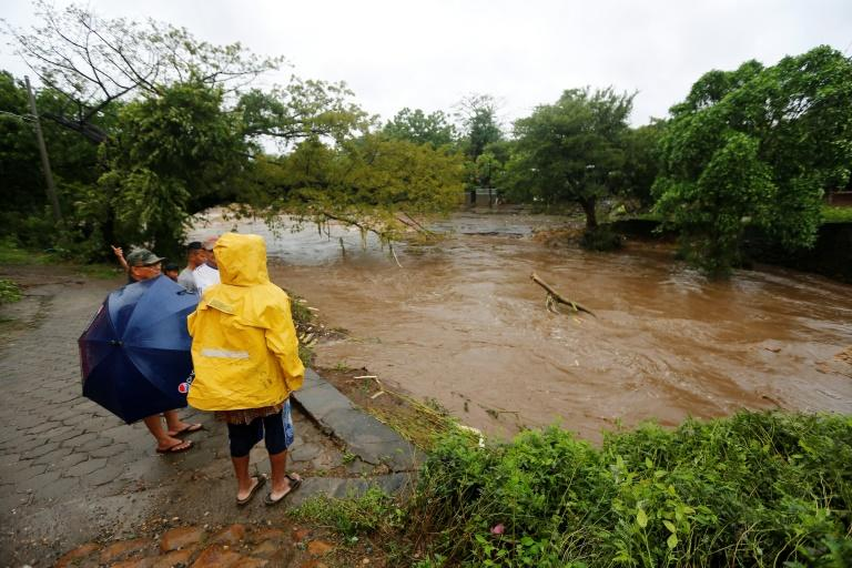 Residents look at the floodings of the Masachapa River following the passage of Tropical Storm Nate in the city of Masachapa, about 60km from the city of Managua on October 5, 2017