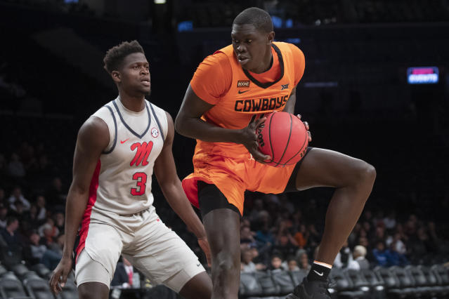Oklahoma State forward Yor Anei (14) drives against Mississippi forward Khadim Sy (3) during the first half of an NCAA college basketball game in the final round of the NIT Season Tip-Off tournament, Friday, Nov. 29, 2019, in New York. (AP Photo/Mary Altaffer)