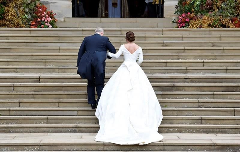 The Latest: British designers made Eugenie's wedding dress