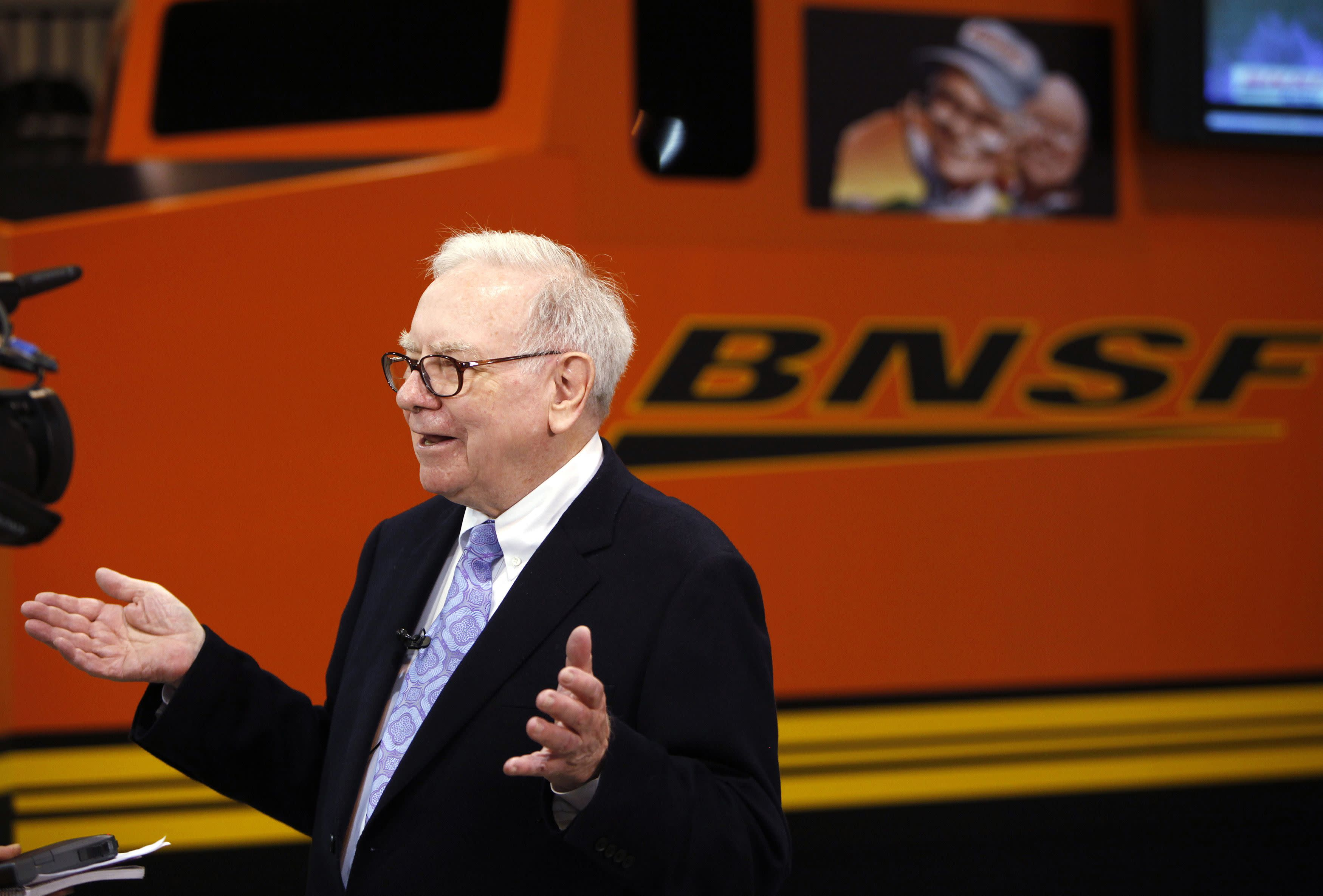 Berkshire Hathaway Chairman Warren Buffett talks in front of a mock BNSF railroad engine. REUTERS/Rick Wilking