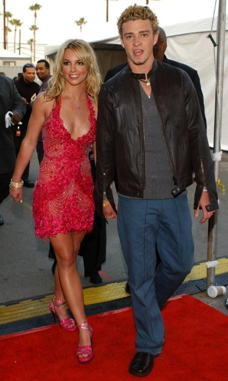 Former lovers Britney Spears (L) and Justin Timberlake at the 29th Annual American Music Awards in Los Angeles in January 2002