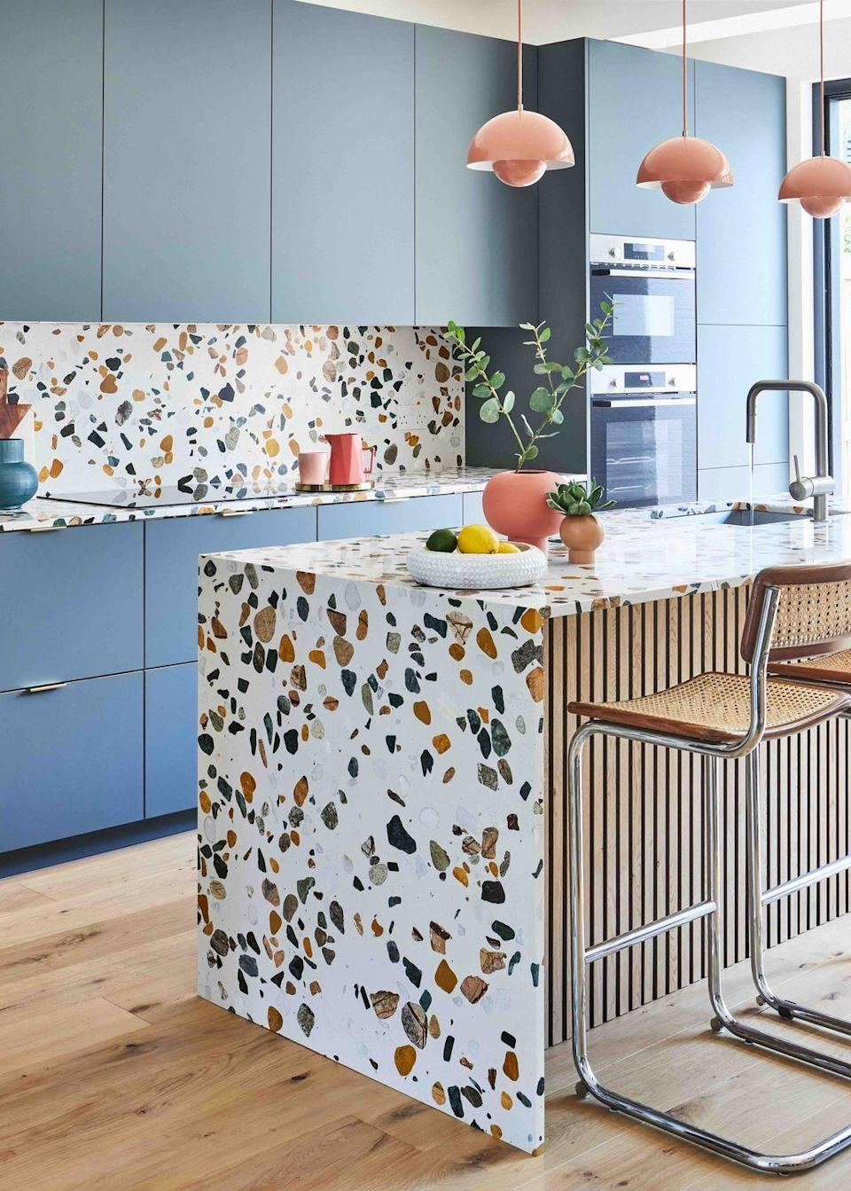 """<p>Kitchen surfaces offer an opportunity to go wild with colour – choose from speckled terrazzo, pigmented concrete, laminate or stained timbers. This kitchen by interior design Nicky Bamford-Bowes has picked out shades of blue and pink from its terrazzo top and splashback, made by specialist Diespeker & Co, to create a harmonious yet bold look. <a href=""""https://www.diespeker.co.uk/"""" rel=""""nofollow noopener"""" target=""""_blank"""" data-ylk=""""slk:diespeker.co.uk"""" class=""""link rapid-noclick-resp"""">diespeker.co.uk</a></p>"""