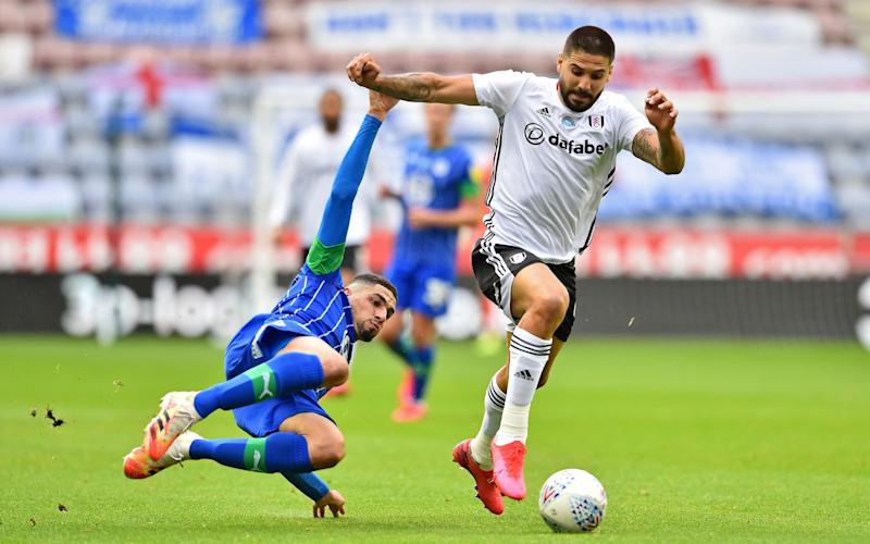 Aleksandar Mitrovic (R) of Fulham is challenged by Leon Balogun of Wigan Athletic during the Sky Bet Championship match between Wigan Athletic and Fulham at DW Stadium on July 22, 2020 in Wigan, England. - GETTY IMAGES