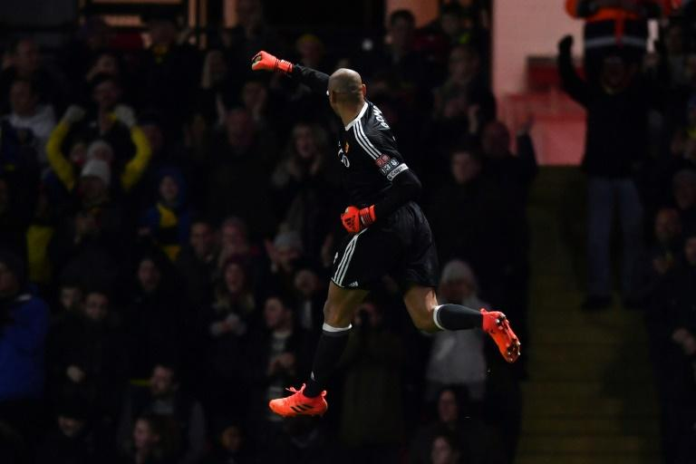 Watford's goalkeeper Heurelho Gomes celebrates their second goal against West Ham United at Vicarage Road Stadium in Watford, north of London on November 19, 2017