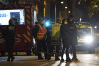 Police officers work at the scene after a Greek Orthodox priest was shot Saturday Oct.31, 2020 while he was closing his church in the city of Lyon, central France. The priest, a Greek citizen, is in a local hospital with life-threatening injuries after being hit in the abdomen, a police official told The Associated Press. (AP Photo/Laurent Cipriani)