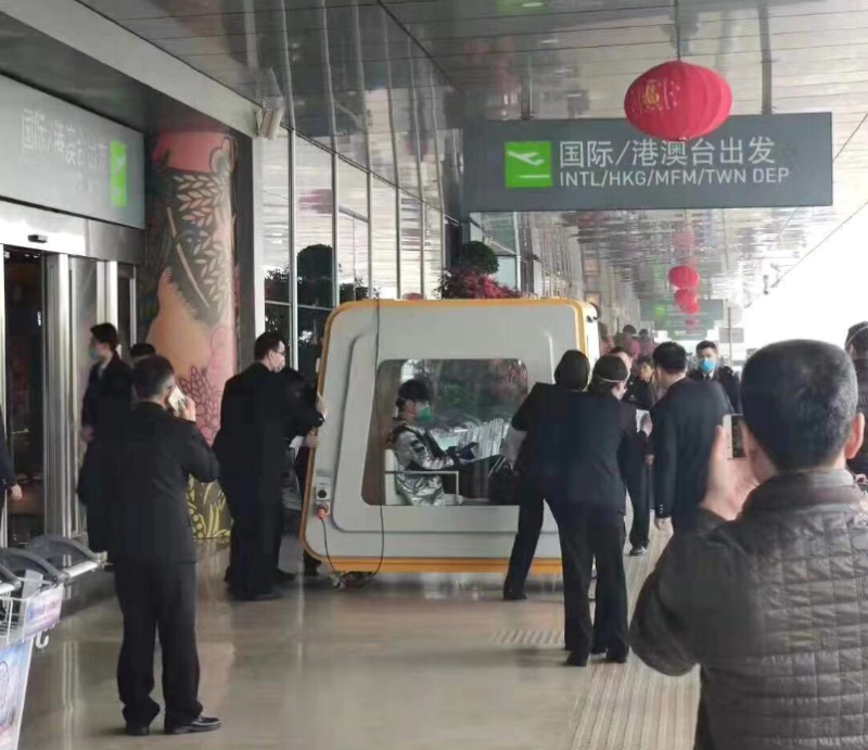 Pictures is a man in a quarantine box outside Fuzhou Airport in China.