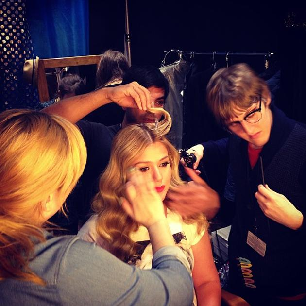 Backstage at the Grammys 2013: Kelly Clarkson tweeted this photo as she had her hair and makeup done before she went on stage. Copyright [Kelly Clarkson]