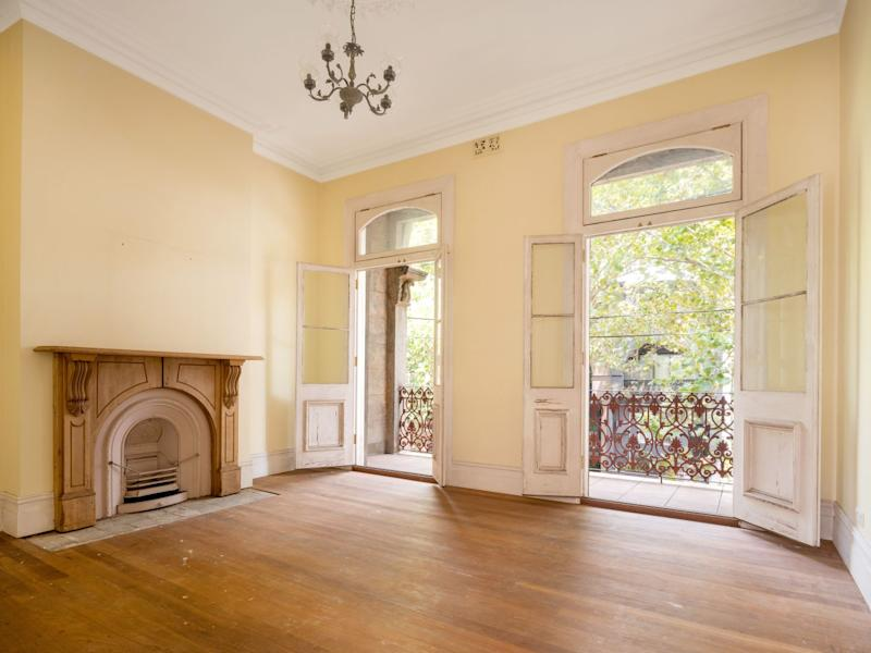 Upstairs picture of 448 Bourke Street, Surry Hills with double French doors open showing the balcony and trees outside